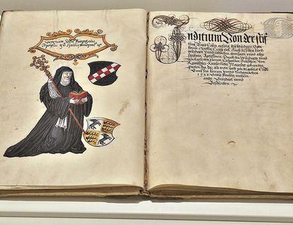 Darstellung Veronikas von Rietheim mit ihrem Wappen auf einer Buchseite